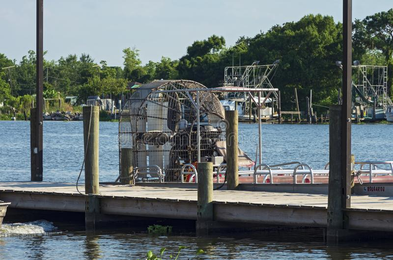 Airboat Docked at Pier in Jean Lafitte stock photography