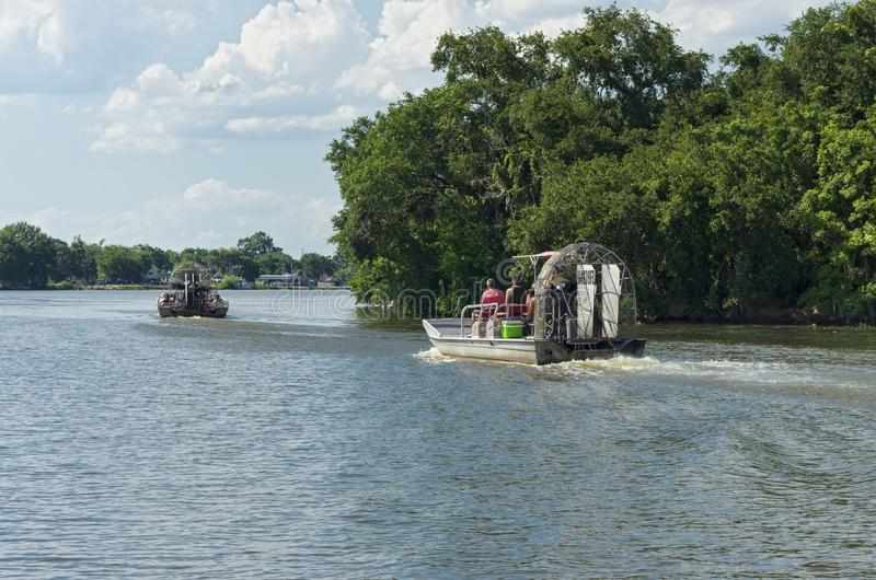 Airboat Tours Begin Journey Toward Bayou. New Orleans, Louisiana/USA - June 13, 2019: Airboat tours begin their journey toward swamps and bayou of Mississippi stock image