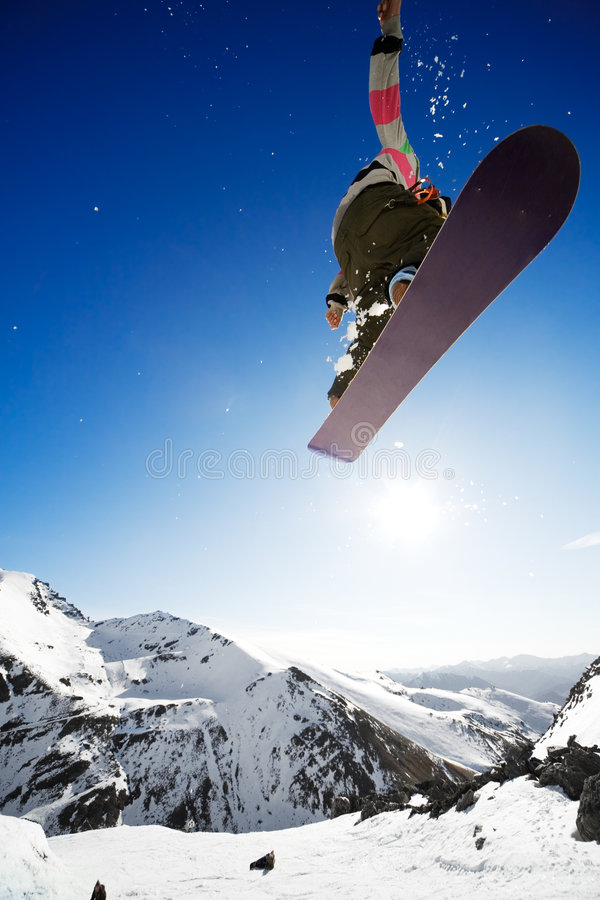 Airborn snowboarder stock photo
