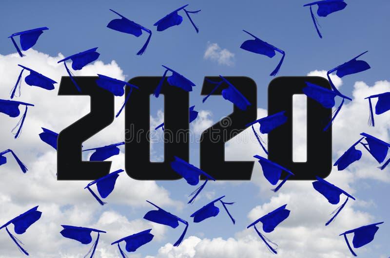 Blue 2020 graduations caps in sky stock photos