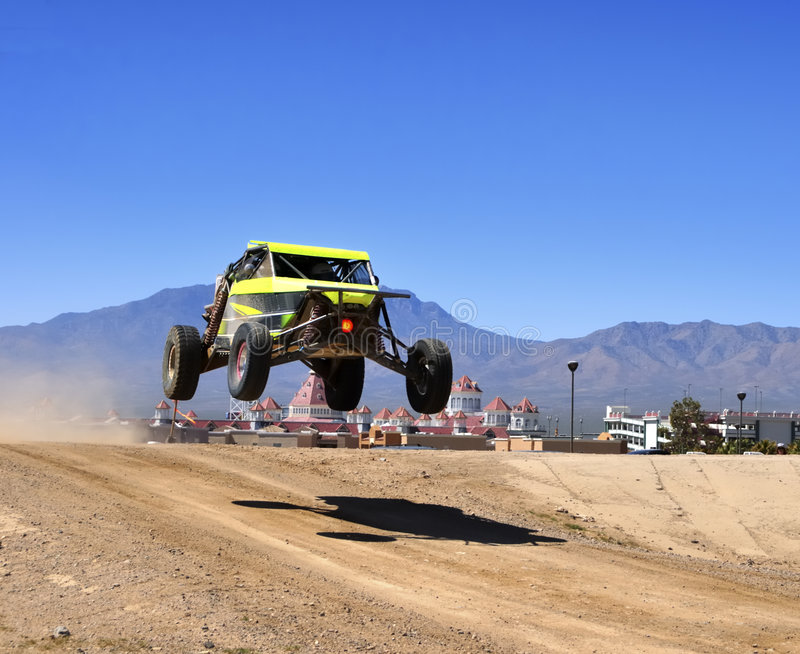 Airborne off-road race car royalty free stock images