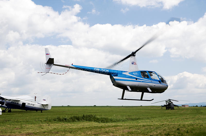 Airborne Robinson R-44 helicopter royalty free stock photography