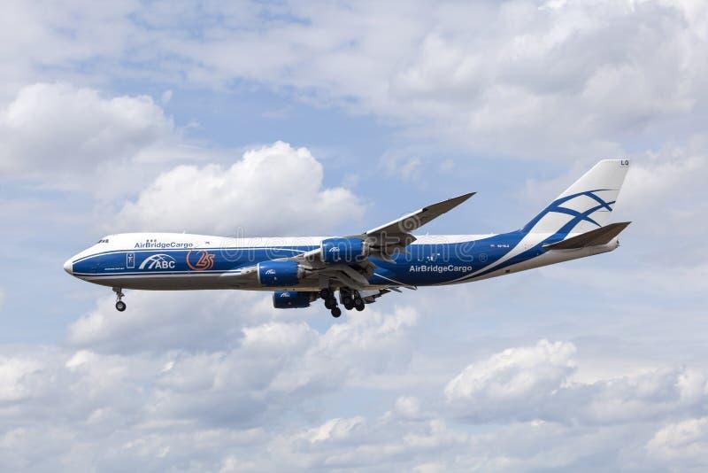 AirBridgeCargo Boeing 747-8F. FRANKFURT, GERMANY - JULY 12, 2016: AirBridgeCargo Boeing 747-8F cargo aircraft approaching Frankfurt Main international airport royalty free stock photos