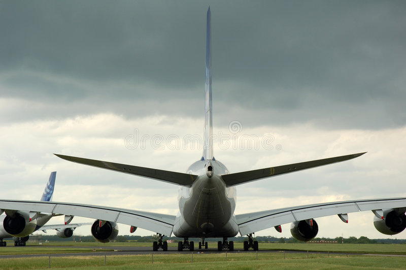 Airbus 380 waiting for takeoff. Airbus 380 sitting on the tarmac waiting for takeoff under a raincloud during an air show in berlin, germany stock photography