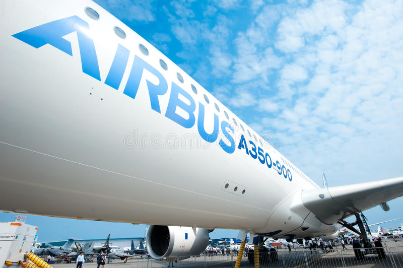 Airbus A350-900 at Singapore Airshow 2014. The all new Airbus A350-900, Airbus' newest plane, on the tarmac at the Singapore Airshow 2014 royalty free stock images