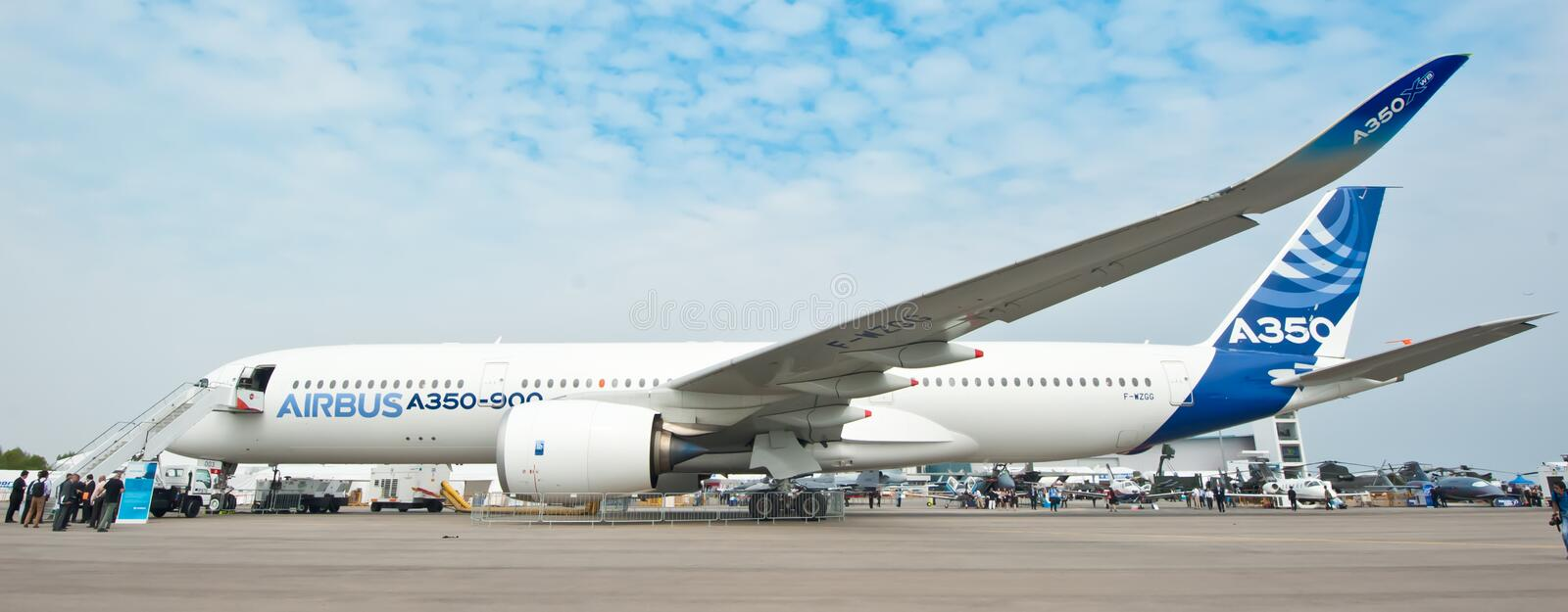Airbus A350-900 at the Singapore Airshow 2014. The all new Airbus A350-900, Airbus' newest plane, on the tarmac at the Singapore Airshow 2014 royalty free stock image