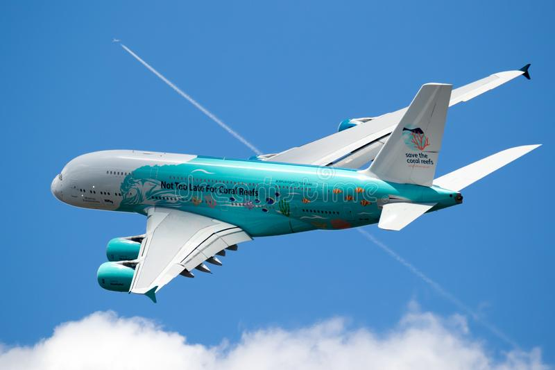 Airbus A380 airliner plane. LE BOURGET PARIS - JUN 21, 2019: Save The Coral Reefs Special livery Airbus A380 passenger plane performing at the Paris Air Show stock photos