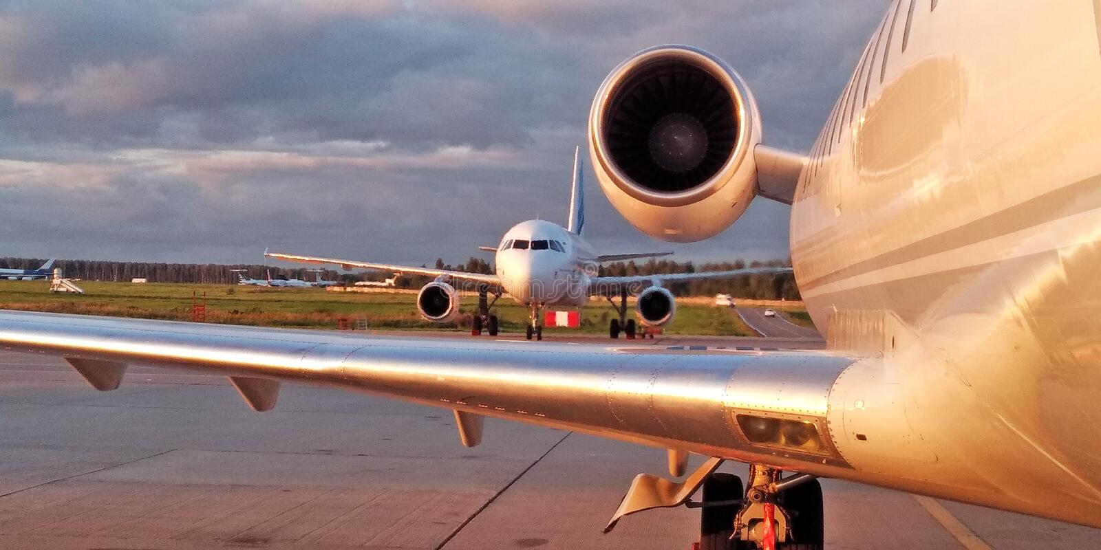 Airbus and Crj-200 on sunset stock photography