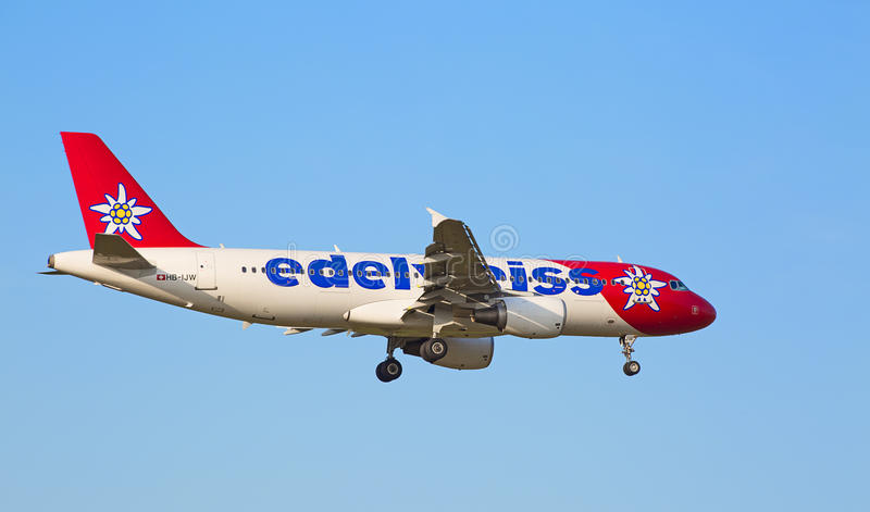 Airbus A319, Edelweiss Air. ZURICH - JULY 18: Airbus A319, Edelweiss Air landing in Zurich airport after short haul flight on July 18, 2015 in Zurich royalty free stock images