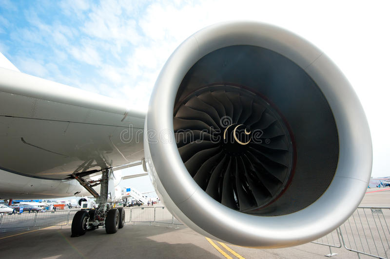 Airbus engine at the Singapore Airshow 2014. The Rolls-Royce Trent XWB engine of the all new Airbus A350-900, Airbus' newest plane, on the tarmac at the stock photo