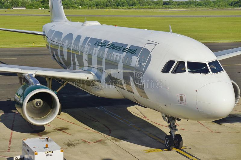 An Airbus A319 from Frontier Airlines. TRENTON, NJ -24 MAY 2015- An Airbus A319 from Frontier Airlines (F9) with a deer on the tail at the Trenton-Mercer Airport stock photography