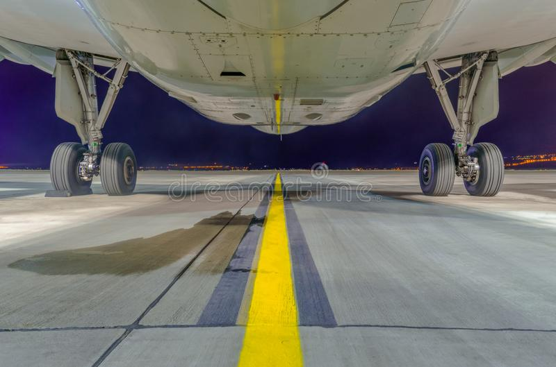Airbus A320-232 fuselage from the bottom and main landing gear. Airbus A320-232 fuselage and main landing gear close up. Bottom and front view. Tbilisi royalty free stock image