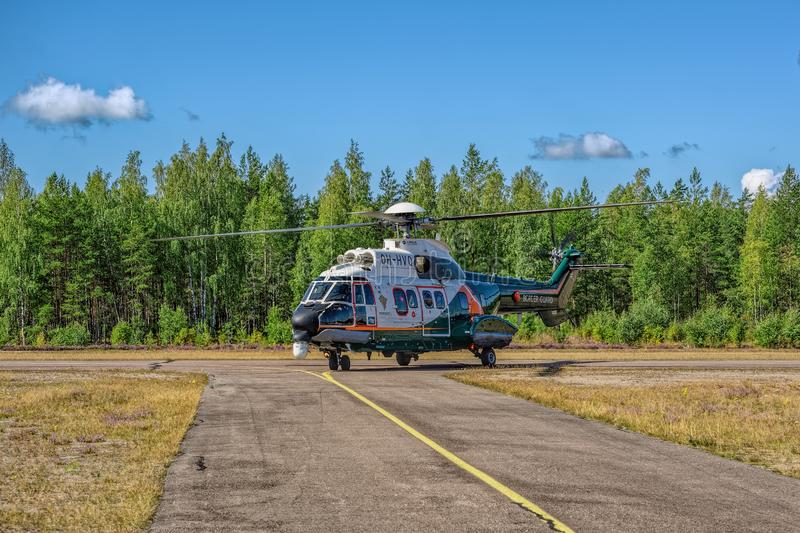 Airbus Helicopters H215 formerly Eurocopter AS332 Super Puma heavy-lift utility aircraft OH-HVP by Finland`s Border Guard royalty free stock photos