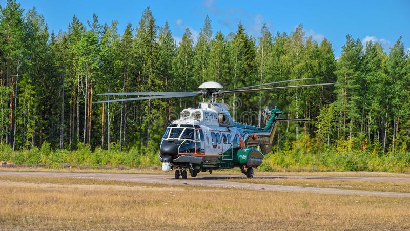 Airbus Helicopters H215 formerly Eurocopter AS332 Super Puma heavy-lift utility aircraft OH-HVP by Finland`s Border Guard. KOTKA, FINLAND - Aug 10, 2019: Airbus royalty free stock photo