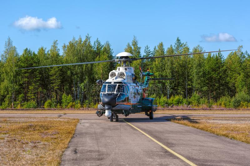 Airbus Helicopters H215 formerly Eurocopter AS332 Super Puma heavy-lift utility aircraft OH-HVP by Finland`s Border Guard. KOTKA, FINLAND - Aug 10, 2019: Airbus stock images