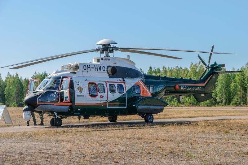Airbus Helicopters H215 formerly Eurocopter AS332 Super Puma heavy-lift utility aircraft OH-HVP by Finland`s Border Guard. KOTKA, FINLAND - Aug 10, 2019: Airbus royalty free stock photos
