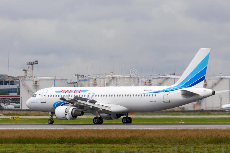 Airbus 320-200 jet aircraft. DOMODEDOVO, RUSSIA - JULY 20: Aircraft operated by JSC Yamal Airlines, take off from Moscow airport in Domodedovo on July 20, 2013 royalty free stock photos