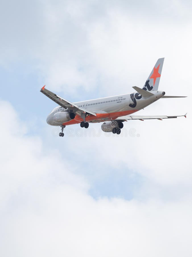 Airbus A320-232 Jetstar Airways. Sydney - February 26, 2016: Large passenger plane Airbus A320-232 Jetstar Ayrvays comes in to land at the airport in Sydney stock photo