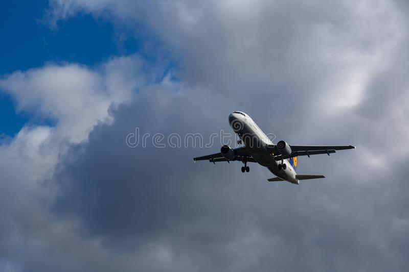 Airbus A320 Lufthansa in a gray stormy sky. GERMANY, FRANKFURT - SEPTEMBER 06, 2015: Airbus A320-211, D-AIPK of Lufthansa in a gray stormy sky stock photo