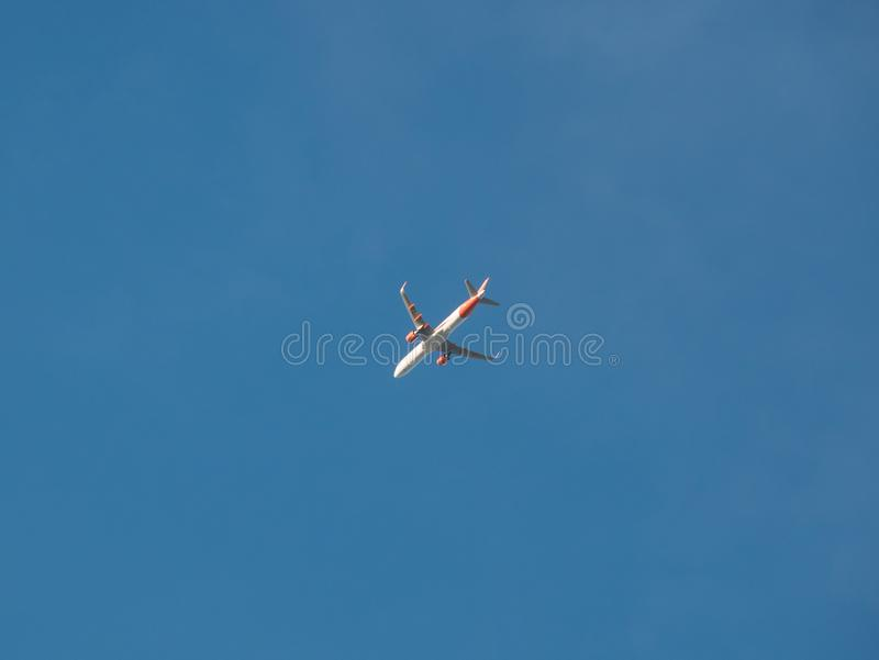 Airbus A321 plane operated by Easyjet flying against blue sky royalty free stock images