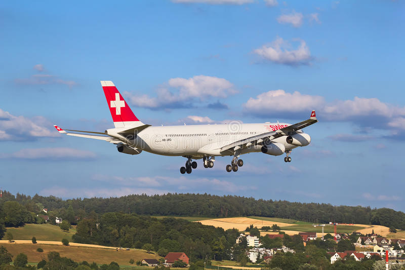 Airbus A-330 Swiss Air. ZURICH - JULY 18: Airbus A-330 landing in Zurich airport after short haul flight on July 18, 2015 in Zurich, Switzerland. Zurich airport royalty free stock images