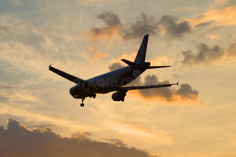 Airbus A320-214 VQ-BDM airlines Ural Airlines in the evening sky royalty free stock photo