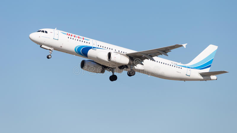 Airbus A321-231 Yamal Airlines. Moscow - August 20, 2015: White-blue passenger aircraft Airbus A321-231 Yamal Airlines takes off at a Russian airport Domodedovo stock images
