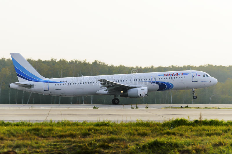 Airbus A320 Yamal Airlines take off. MOSCOW, RUSSIA - SEPTEMBER 26, 2014: Airbus A321 Yamal Airlines take off at Domodedovo international airport royalty free stock image