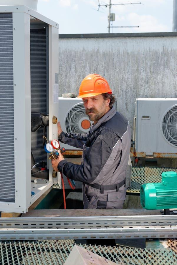 Airconditioningsreparatie, stock foto