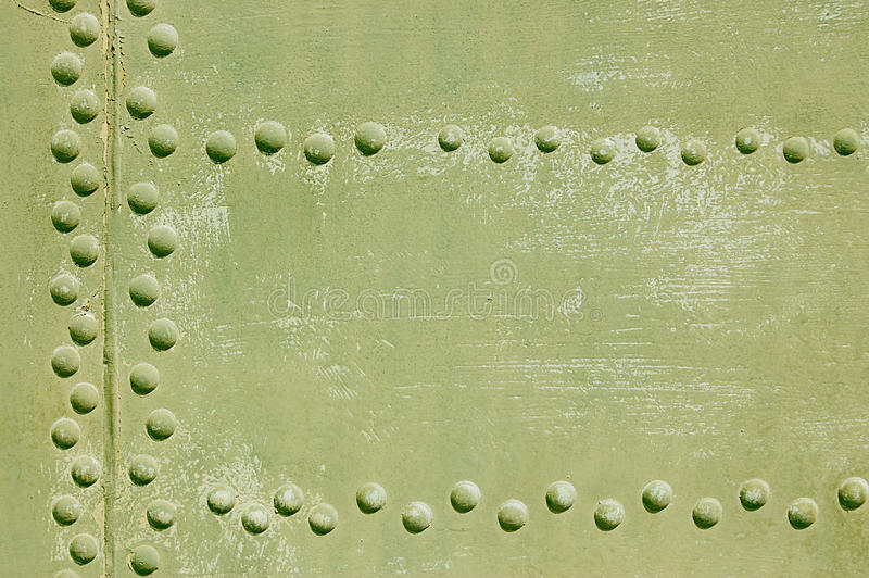 Aircraft. The riveted covering of a fuselage of the old military plane royalty free stock images