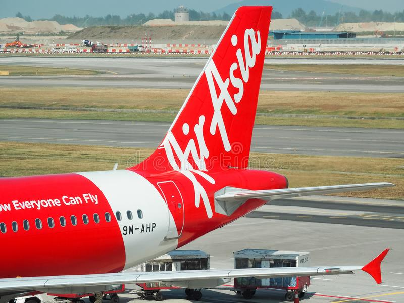 Aircraft of the Air Asia Airline waiting for passengers royalty free stock photo