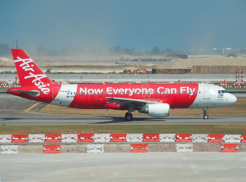 Aircraft of the Air Asia Airline waiting for passengers stock photos