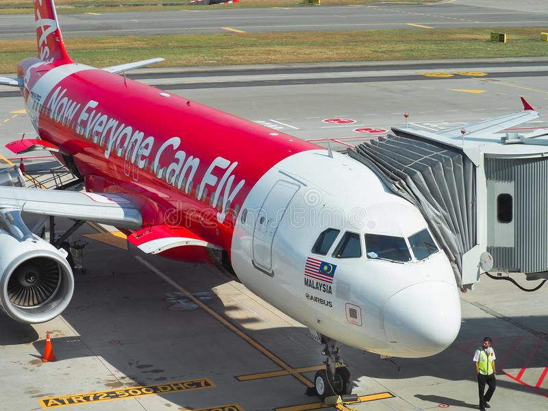 Aircraft of the Air Asia Airline waiting for passengers stock photography