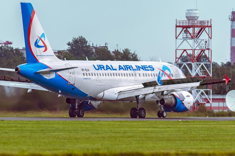Aircraft Airbus A319 of Ural Airlines is taxi on the runway royalty free stock photography