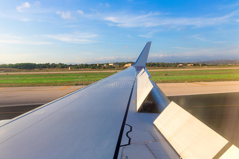 Aircraft airplane wing in landing process stock image