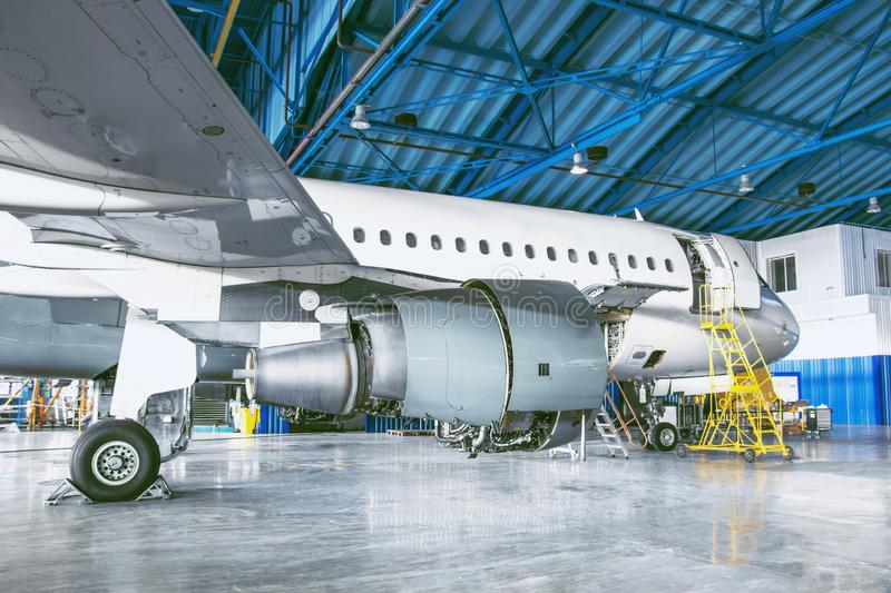 The aircraft is in the aviation hangar. Theme repair and maintenance of airplane airlines.  stock images