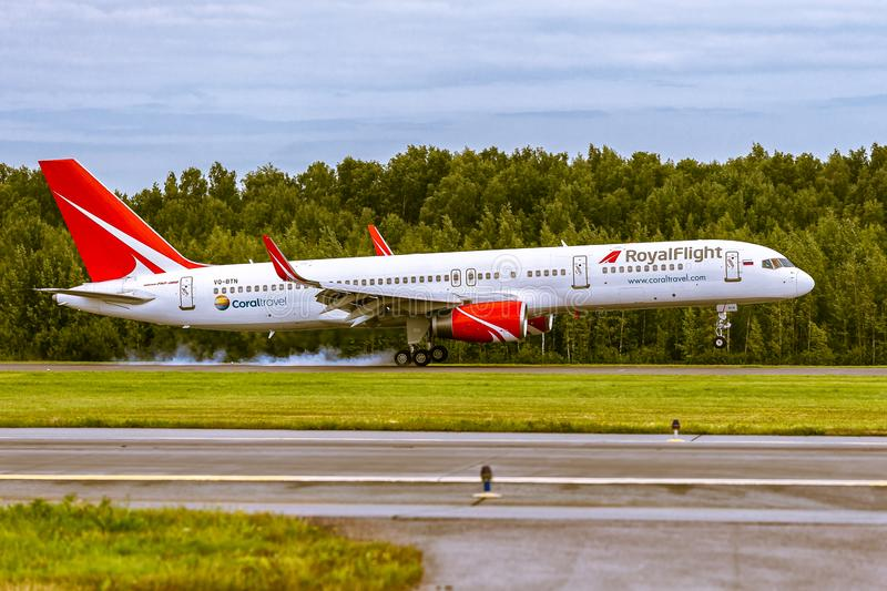 Aircraft Boeing B757 of RoyalFlight is landing on the runway at airport Pulkovo royalty free stock image