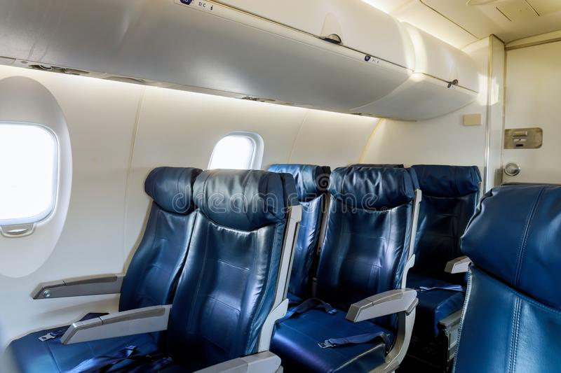 Armchairs in a built-in chairs Aircraft Cabin Economy class. Aircraft cabin economy class armchairs in a built-in chairs, flight, airliner, comfortable, seating royalty free stock images