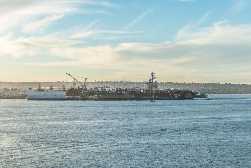 Aircraft carrier docked Navy Pier in San Diego royalty free stock image