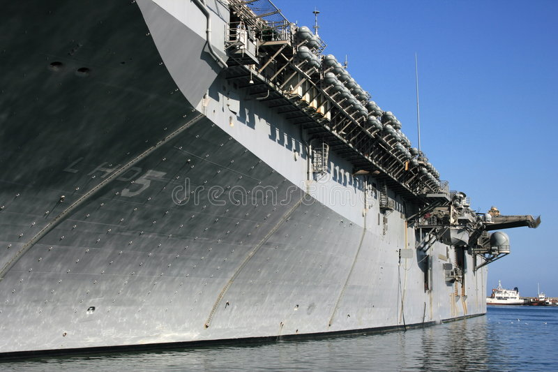 Aircraft carrier at the docks stock photography