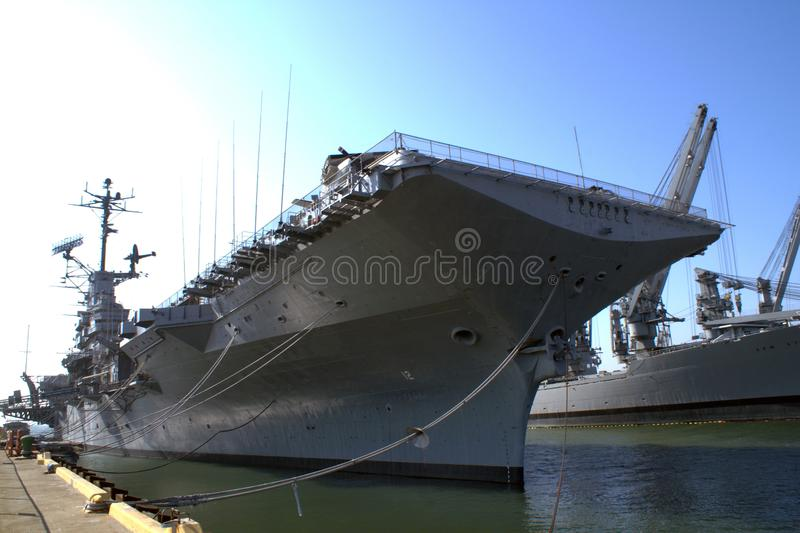 Aircraft carrier of the US Army at the pier in the city of Alameda. American aircraft carrier of the 20th century. The time of the Cold War between the USSR and stock photos