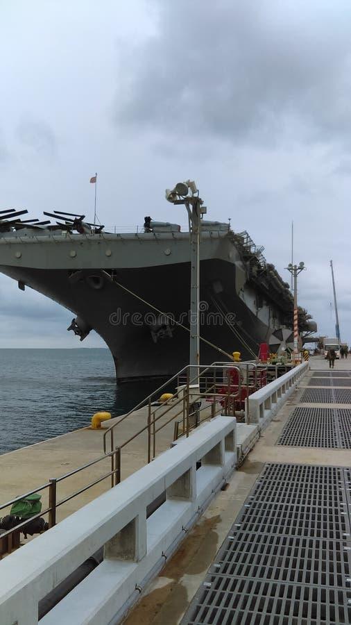 Aircraft carrier white beach Japan royalty free stock photos