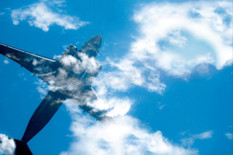 Aircraft in cloud blue sky. Top view with copy space. Travel or journey concept  background royalty free stock photography