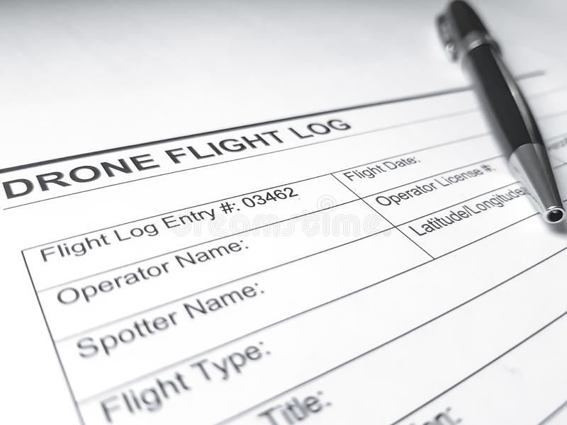 A drone flight log page on a white surface, with a black pen. Aircraft documentation, aviation report, paperwork for unmanned aerial vehicles stock photo