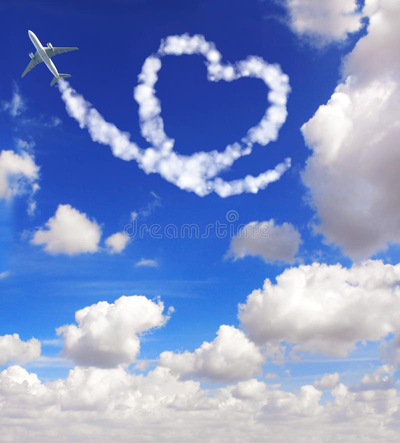 Aircraft draw a heart in the sky. Love concept for traveling the world royalty free stock image