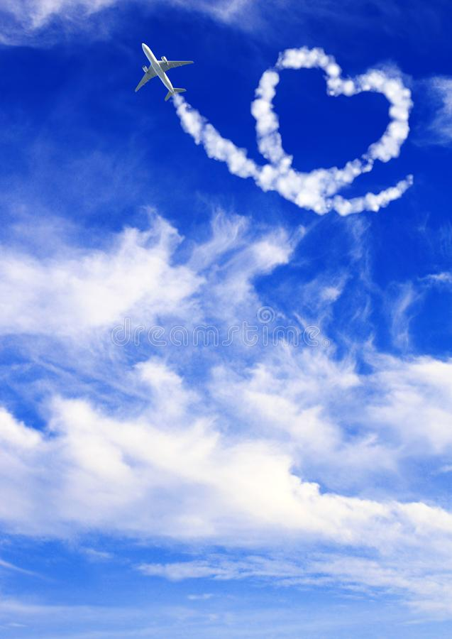Aircraft draw a heart in the sky. Love concept for traveling the world royalty free stock photo