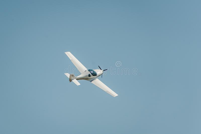 Aircraft flies and shows a performance at the airshow in the clear blue sky royalty free stock photography