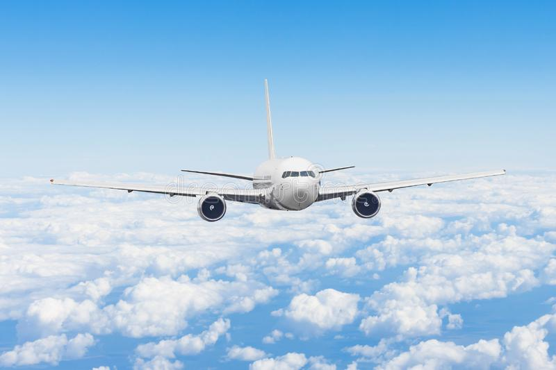 Aircraft fly high in the sky above the summer clouds.  royalty free stock photography