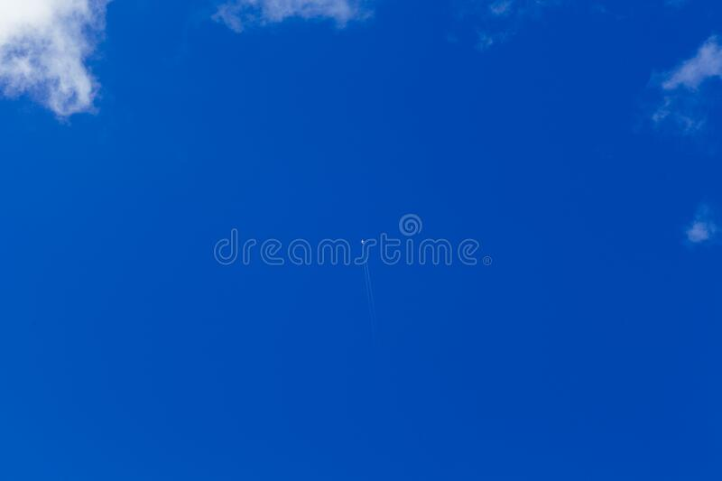 Aircraft flying in blue sky royalty free stock images