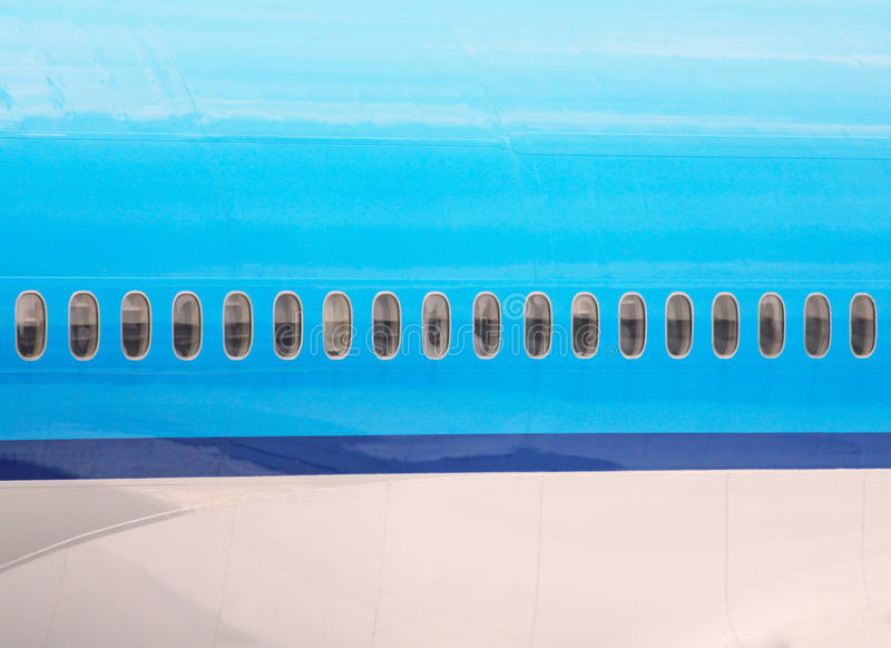 Aircraft fuselage. Windows of an aircraft fuselage stock images